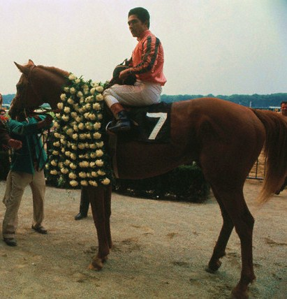 Heliodoro Gustines and Stage Door Johnny in the winner's circle of the Belmont Stakes, 1968